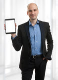 Businessman presenting something on a tablet Stock Photos