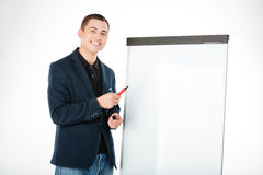 Businessman presenting something on whiteboard Royalty Free Stock Images