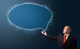Businessman presenting speech bubble copy space Royalty Free Stock Images