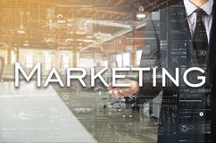Businessman presenting text Marketing on virtual screen. He is i stock photos