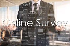 Businessman presenting text Online Survey on virtual screen. He stock photos