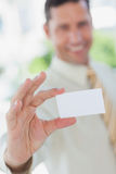 Businessman presenting white business card Stock Photo