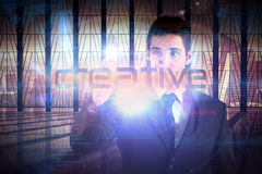 Businessman presenting the word creative Royalty Free Stock Photography