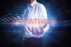 Businessman presenting the word creativity Royalty Free Stock Images