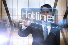 Businessman presenting the word hotline Royalty Free Stock Images