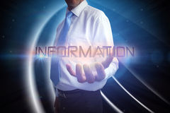 Businessman presenting the word information Royalty Free Stock Photos