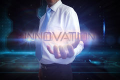 Businessman presenting the word innovation Royalty Free Stock Photo