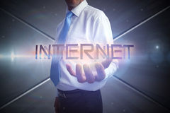 Businessman presenting the word internet Stock Photography