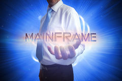 Businessman presenting the word mainframe Royalty Free Stock Image