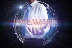 Businessman presenting the word malware Stock Photos
