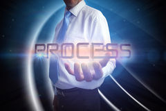 Businessman presenting the word process Stock Photo