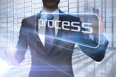 Businessman presenting the word process Royalty Free Stock Photos