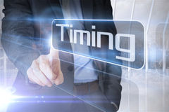 Businessman presenting the word timing stock photography