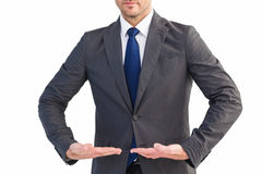 Businessman presenting your product with hands Royalty Free Stock Photos