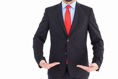 Businessman presenting your product with hands Royalty Free Stock Photography