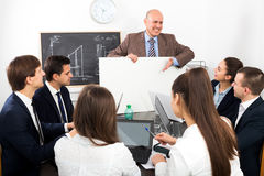Businessman presents new development plan at poster Royalty Free Stock Photo