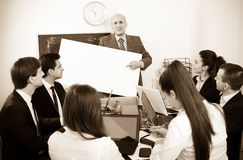 Businessman presents new development plan at poster Stock Images