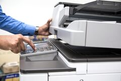 Free Businessman Press Button Using Photocopier Or Printer Is Office Work Tool Equipment Royalty Free Stock Images - 190227929