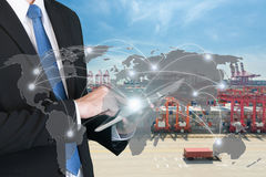 Businessman press digital tablet to show global network partners stock image