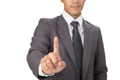 Businessman press imaginary button on touch screen interface Royalty Free Stock Photos