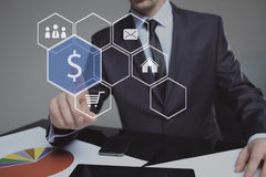 Businessman presses digital interface dollar sign. Business, technology, internet and networking concept stock photo