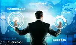 Businessman presses futuristic interface Royalty Free Stock Photo