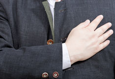 Businessman presses his hand to heart - hand gesture Stock Photos