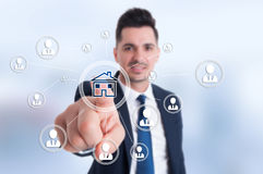 Businessman presses smart home icon. And contacts connected all together Stock Image