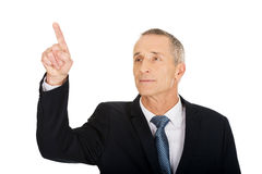 Businessman pressing abstract button Stock Photography