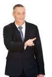 Businessman pressing an abstract button Stock Photos