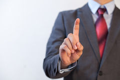 Businessman pressing in the air with one finger - Digital and im. Agination concept Royalty Free Stock Image