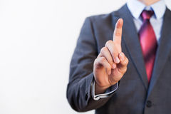 Businessman pressing in the air with one finger Royalty Free Stock Photo