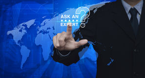 Businessman pressing ask an expert, Elements of this image furnished by NASA Royalty Free Stock Images
