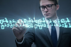 The businessman pressing binary buttons in tech concept Stock Images