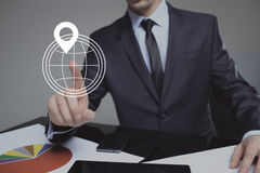 Businessman pressing button touch screen interface GPS icon. business concept Royalty Free Stock Photography
