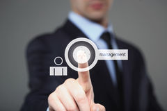 Businessman pressing button on touch screen interface and select management.  internet, technology concept. Stock Photography