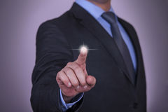 Businessman pressing button on touch screen Royalty Free Stock Images