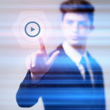 Businessman pressing button virtual screens Royalty Free Stock Images