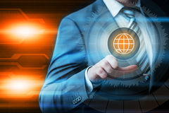 Businessman pressing button virtual screens Royalty Free Stock Photos