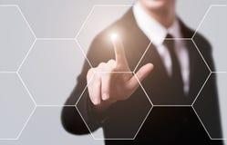 Businessman pressing button on virtual screens Royalty Free Stock Photos