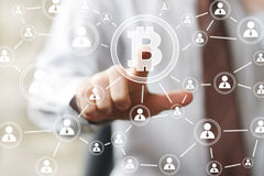 Businessman pressing button web bitcoin icon Royalty Free Stock Photography