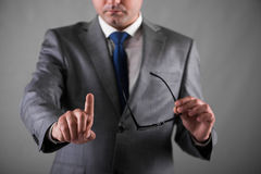 The businessman pressing buttons in business concept. Businessman pressing buttons in business concept Stock Images