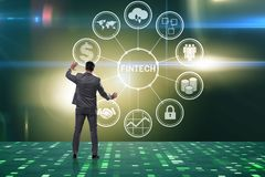 The businessman pressing buttons in fintech concept. Businessman pressing buttons in fintech concept Royalty Free Stock Photo