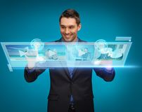 Businessman pressing buttons on virtual screen Stock Photography