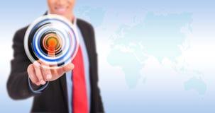 Businessman pressing circle button Stock Photos