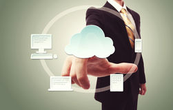 Businessman pressing cloud icon Stock Image