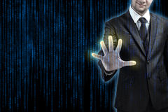 Businessman pressing at code on digital touchscreen Royalty Free Stock Photo