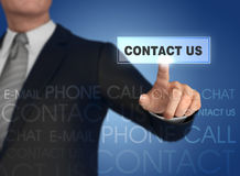 Businessman pressing contact icon 3d illustration Royalty Free Stock Photography