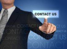 Businessman pressing contact icon 3d illustration. Businessman pressing contact icon with finger 3d illustration Royalty Free Stock Image