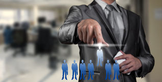 Businessman pressing on digital virtual screen, human resource Stock Image